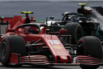 Ferrari driver Charles Leclerc of Monaco steers his car followed by Mercedes driver Valtteri Bottas of Finland during the second practice session for the British Formula One Grand Prix at the Silverstone racetrack, Silverstone, England, Friday, July 31, 2020. The British Formula One Grand Prix will be held on Sunday. (AP Photo/Frank Augstein,Pool)