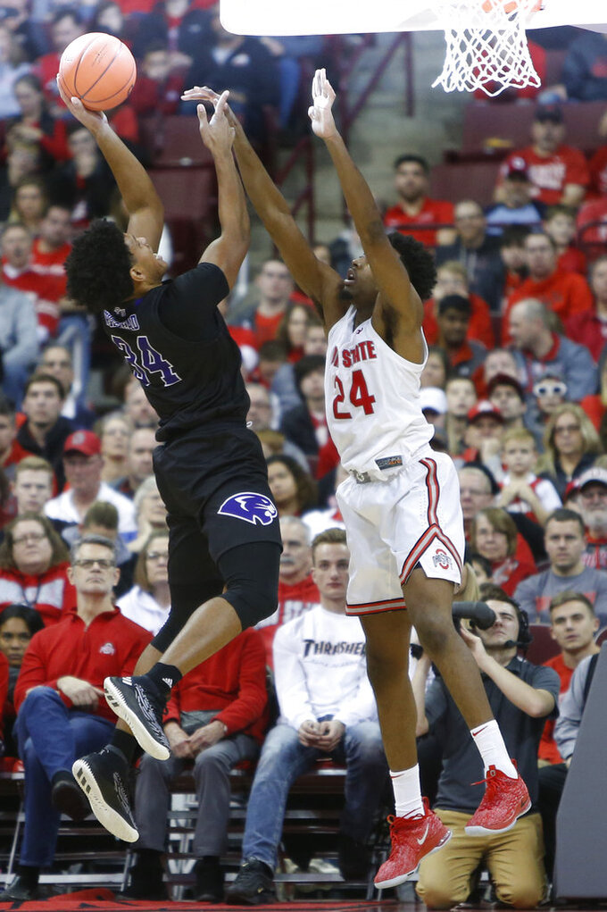 Ohio State's Andre Wesson, right, tries to block the shot of High Point's Jordan Whitehead during the second half of an NCAA college basketball game Saturday, Dec. 29, 2018, in Columbus, Ohio. Ohio State beat High Point 82-64. (AP Photo/Jay LaPrete)