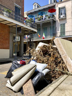 Debris from Hurricane Ida sits on a curb beneath balconies in the French Quarter in New Orleans on Thursday, Sept. 2, 2021. With nearly all the power back on in New Orleans nearly two weeks after Ida stuck, the city is showing signs of making a comeback from the Category 4 killer. (AP Photo/Stacey Plaisance)