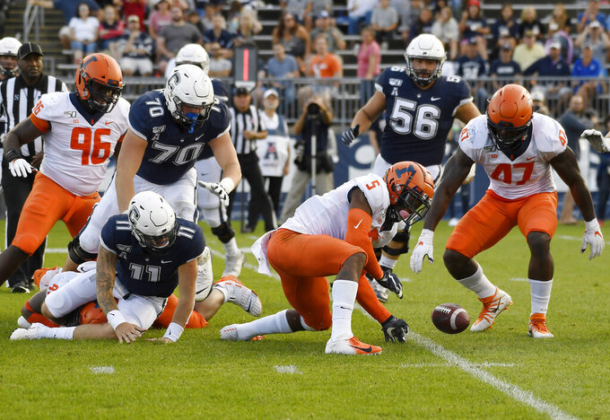 Illinois linebacker Milo Eifler (5) and Illinois defensive lineman Oluwole Betiku Jr. (47) reach to take possession of a ball fumbled by Connecticut quarterback Jack Zergiotis (11) during the second half of an NCAA college football game, Saturday, Sept. 7, 2019, in East Hartford, Conn. (AP Photo/Jessica Hill)