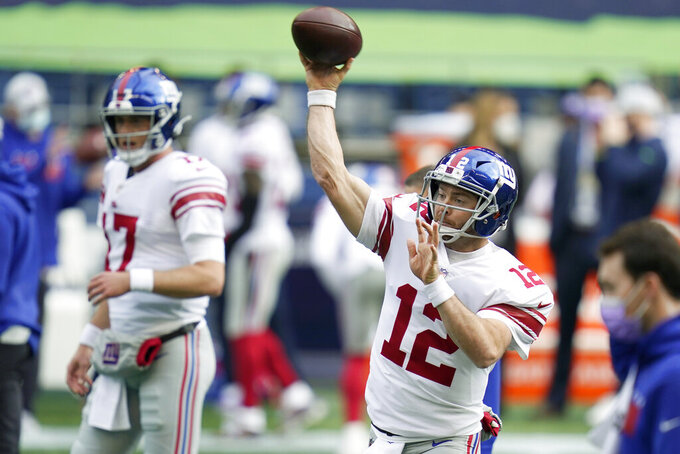 New York Giants quarterback Colt McCoy passes as he warms up before an NFL football game against the New York Giants, Sunday, Dec. 6, 2020, in Seattle. (AP Photo/Elaine Thompson)