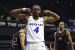 Hofstra guard Desure Buie (4) reacts after he was fouled during the second half against of an NCAA college basketball game against Northeastern in the championship of the Colonial Athletic Association men's tournament Tuesday, March 10, 2020, in Washington. Hofstra won 70-61. (AP Photo/Nick Wass)