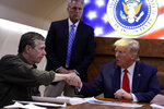 President Donald Trump participates in a briefing with North Carolina Gov. Roy Cooper about Hurricane Dorian at Marine Corps Air Station Cherry Point, Monday, Sept. 9, 2019, in Havelock, N.C., aboard Air Force One. (AP Photo/Evan Vucci)