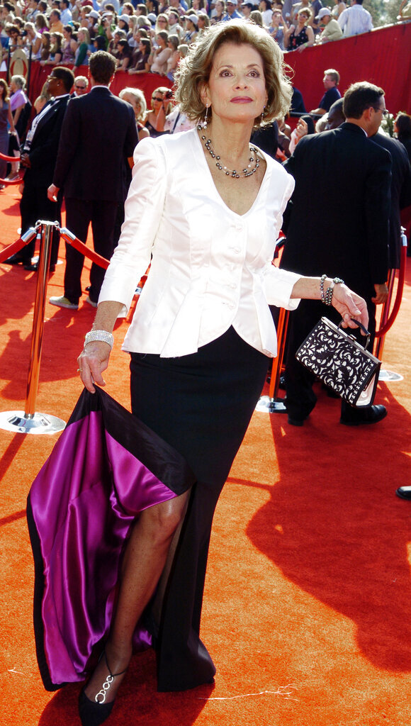 """FILE - Jessica Walter arrives for the 57th Annual Primetime Emmy Awards on Sept. 18, 2005, Los Angeles. Walter, who played a scheming matriarch in TV's """"Arrested Development,"""" has died. She was 80. Walter's death was confirmed Thursday, March 25, 2021, by her daughter, Brooke Bowman. The actor's best-known film roles included playing the stalker in Clint Eastwood's 1971 thriller, """"Play Misty for Me."""" (AP Photo/Chris Pizzello, File)"""