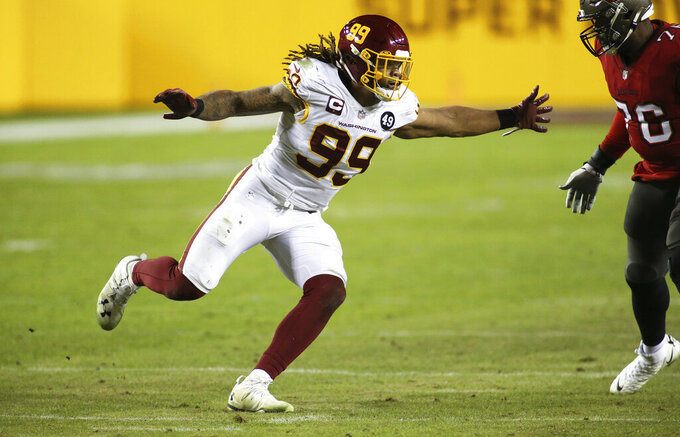 FILE - In this Jan. 9, 2021, file photo, Washington Football Team defensive end Chase Young (99) rushes in the team's NFL wild-card playoff football game against the Tampa Bay Buccaneers in Landover, Md. Young got The Associated Press' top defensive rookie award Saturday, Feb. 6. (AP Photo/Daniel Kucin Jr., File)