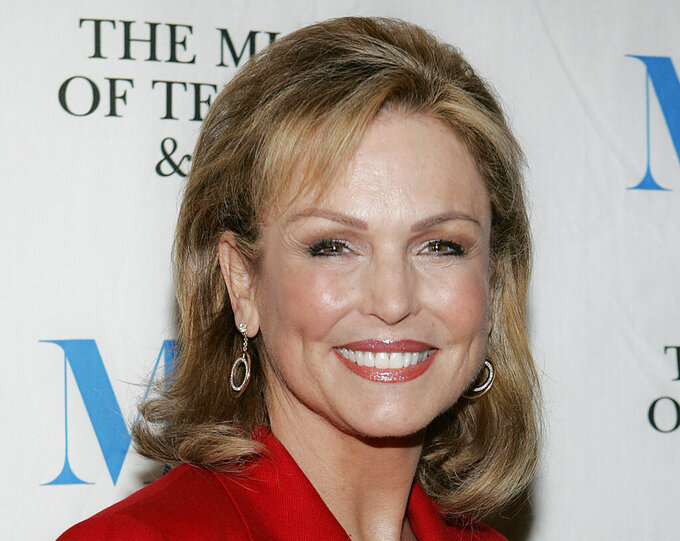 "FILE - In this Dec. 1, 2005, file photo, Phyllis George arrives at the Museum of Television and Radio ""She Made It"" launch party in New York. George, the former Miss America who became a female sportscasting pioneer on CBS's ""The NFL Today"" and served as the first lady of Kentucky, has died. She was 70. A family spokeswoman said George died Thursday, May 14, 2020, at a Lexington hospital after a long fight with a blood disorder.  (AP Photo/Stephen Chernin, File)"
