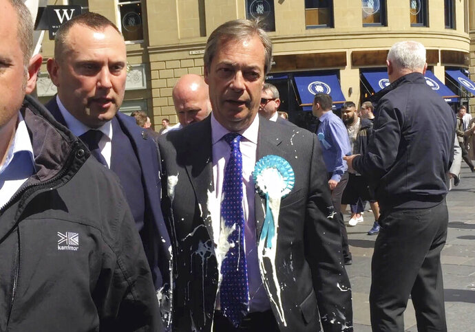 Brexit Party leader Nigel Farage after being hit with a milkshake during a campaign walkabout for the upcoming European elections in Newcastle, England, Monday May 20, 2019. (Tom Wilkinson/PA via AP)