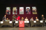 In this photo taken Tuesday, Jan. 28, 2020, eight candidates who seek the Democratic nomination in an open race for New Mexico's 3rd Congressional District gathered to answer questions from teenage girls affiliated with the youth empowerment group Girls Inc. at a forum in Santa Fe, N.M. From left to right, the candidates are John Blair, Teresa Leger Fernandez, Dineh Benally, Laura Montoya, Valerie Plame, Joseph Sanchez, Marco Serna and Kyle Tisdel. Candidates were asked to pick a superpower if they could, as they vie for attention in a crowded contest to succeed Rep. Ben Ray Lujan, who is running as a Democrat to succeed retiring Sen. Tom Udall. (AP Photo/Morgan Lee)
