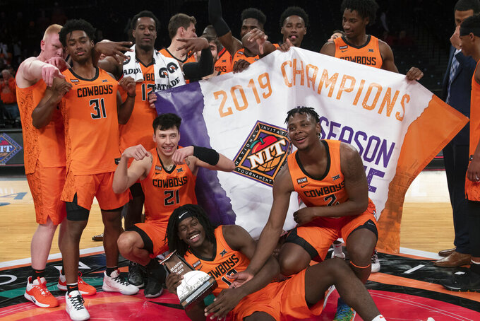 Oklahoma State players pose for a photo after defeating Mississippi 78-37 in the NCAA college basketball NIT Season Tip-Off tournament championship game, Friday, Nov. 29, 2019, in New York. (AP Photo/Mary Altaffer)