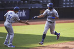 Los Angeles Dodgers' Chris Taylor is congratulated by Dino Ebel after hitting a solo home run off San Diego Padres relief pitcher Garrett Richards during the sixth inning of a baseball game Wednesday, Sept. 16, 2020, in San Diego. (AP Photo/Derrick Tuskan)