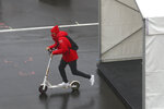 Ferrari driver Sebastian Vettel of Germany rides on a scooter ahead the second practice session for the Eifel Formula One Grand Prix at the Nuerburgring racetrack in Nuerburg, Germany, Friday, Oct. 9, 2020. The Germany F1 Grand Prix will be held on Sunday. (AP Photo/Matthias Schrader, Pool)