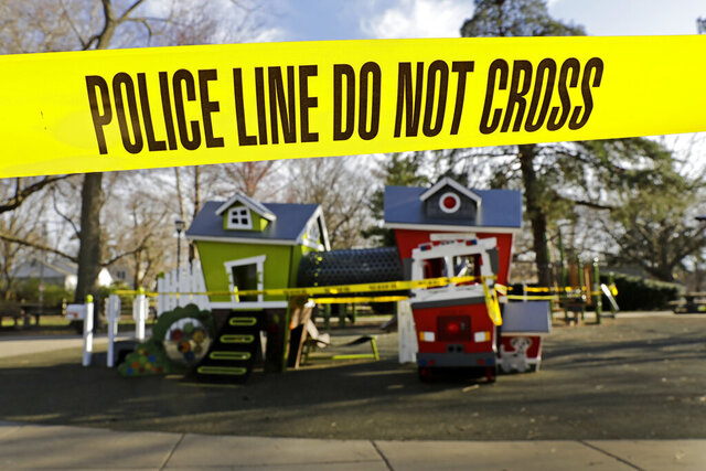 Police tape is used to keep people from using a playground that was closed in an effort to help prevent the spread of the coronavirus, Wednesday, March 25, 2020, in Fairway, Kan. (AP Photo/Charlie Riedel)