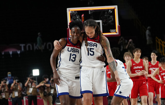 United States's Sylvia Fowles (13) and Brittney Griner (15) celebrate after their win in the women's basketball gold medal game against Japan at the 2020 Summer Olympics, Sunday, Aug. 8, 2021, in Saitama, Japan. (AP Photo/Eric Gay)
