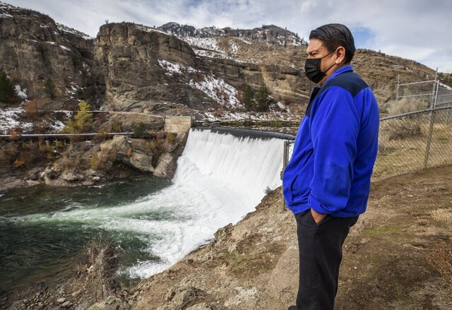 Rodney Cawston, chairmen of the Colville tribe business council, stands at the site of the Enloe Dam on Wednesday, Oct. 28, 2020, in Oroville, Wash. The Colville tribe wants the dam, which blocks fish from reaching the Similkameen River, removed.  (Steve Ringman/The Seattle Times via AP)
