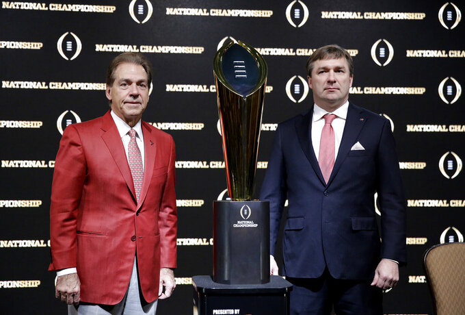 FILE - In this Jan. 7, 2018, file photo, Alabama head coach Nick Saban, left, and Georgia head coach Kirby Smart pose with the NCAA college football championship trophy at a press conference in Atlanta. Neither No. 1 Alabama nor No. 4 Georgia is anxiously awaiting their playoff fates this season, but whoever wins the SEC championship game showdown is definitely in the playoffs. The Crimson Tide could even get in with a close loss. (AP Photo/David Goldman, File)