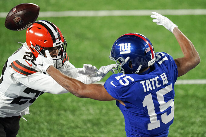 Cleveland Browns' Kevin Johnson, left, defends New York Giants' Golden Tate (15) during the second half of an NFL football game, Sunday, Dec. 20, 2020, in East Rutherford, N.J. (AP Photo/Seth Wenig)