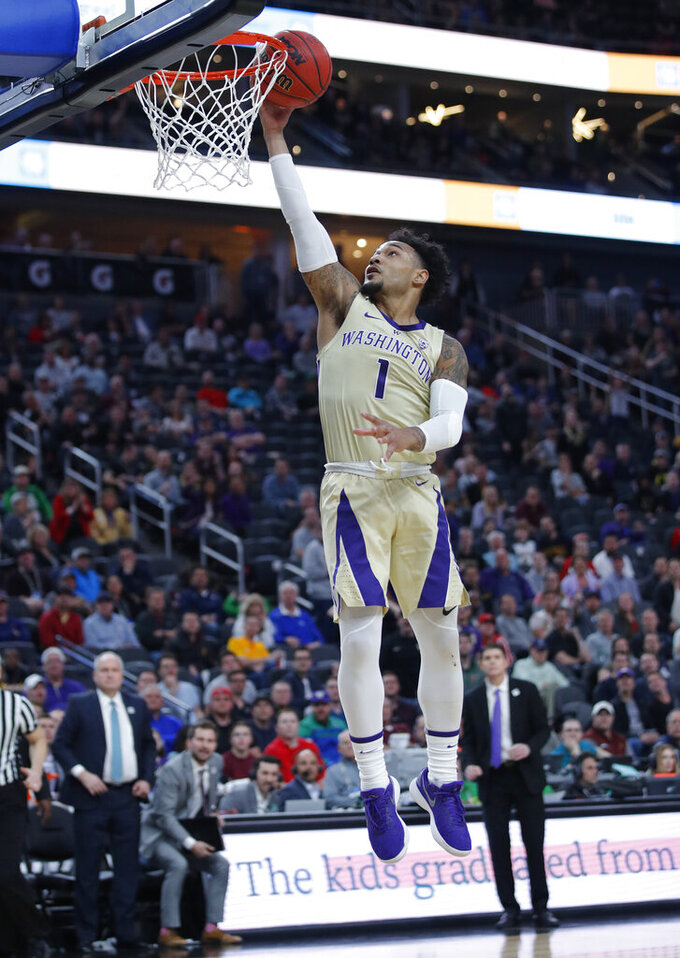 Washington's David Crisp shoots against Colorado during the second half of an NCAA college basketball game in the semifinals of the Pac-12 men's tournament Friday, March 15, 2019, in Las Vegas. (AP Photo/John Locher)