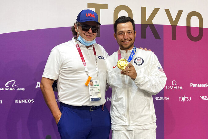 Xander Schauffele, of the United States, poses with his gold medal in the men's golf event with his dad, Stefan, at the 2020 Summer Olympics on Sunday, Aug. 1, 2021, in Kawagoe, Japan. (AP Photo/Doug Ferguson)