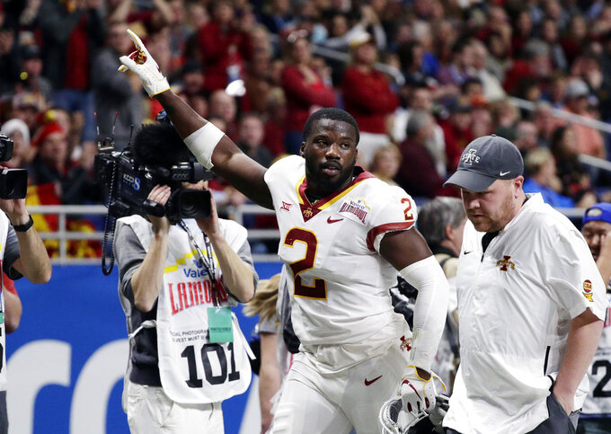 Iowa State linebacker Willie Harvey (2) leaves the field after he was ejected for targeting during the the first half against Washington State in the Alamo Bowl NCAA college football game Friday, Dec. 28, 2018, in San Antonio. (AP Photo/Eric Gay)