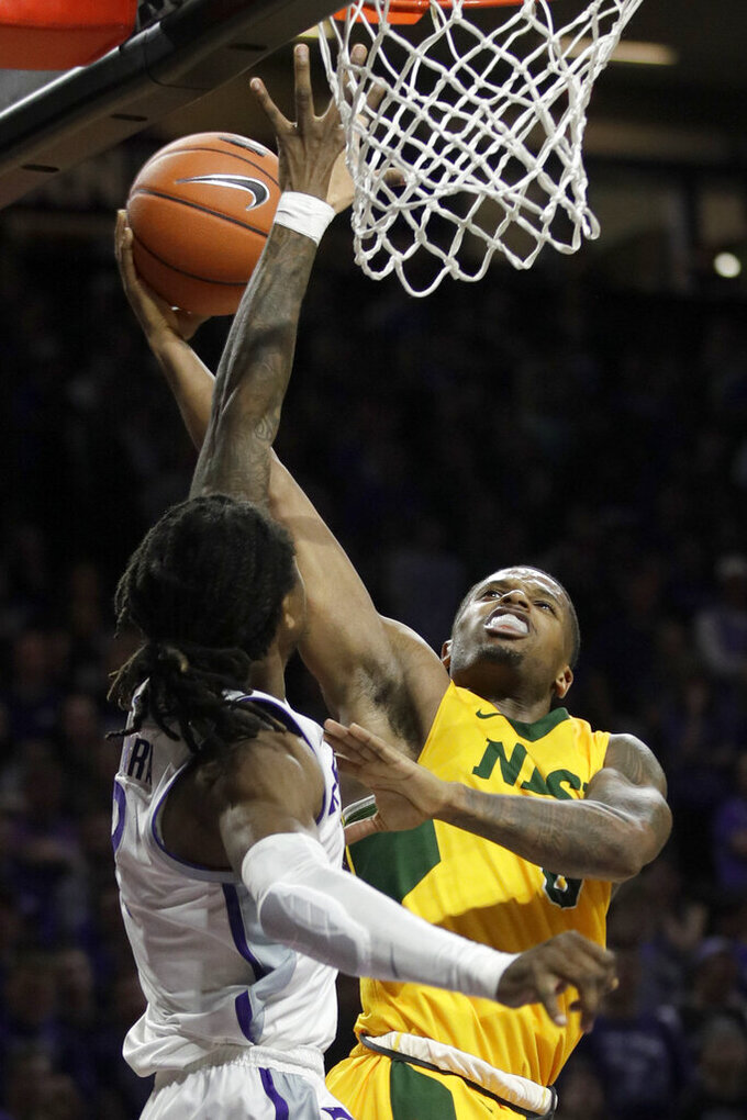 Kansas State guard Cartier Diarra, left, blocks a shot by North Dakota State guard Vinnie Shahid (0) during the first half of an NCAA college basketball game in Manhattan, Kan., Tuesday, Nov. 5, 2019. (AP Photo/Orlin Wagner)