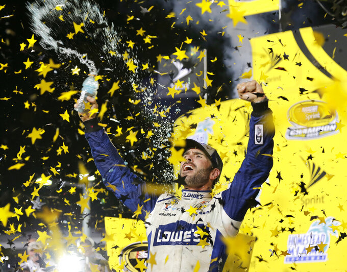 FILE - In this Nov. 20, 2016, file photo, Jimmie Johnson celebrates his NASCAR Sprint Cup auto race and season title win, in Homestead, Fla. Seven-time NASCAR champion Jimmie Johnson says 2020 will be his final season of full-time racing. The winningest driver of his era will have a 19th season in the No. 48 Chevrolet and once again chase a record eighth championship. Johnson made the announcement in a video posted on social media, Wednesday, Nov. 20, 2019. (AP Photo/Terry Renna, File)