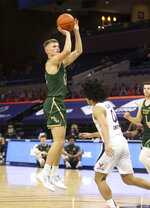 William & Mary guard Luke Loewe (12) shoots over Virginia guard Kihei Clark (0) during an NCAA college basketball  game Tuesday, Dec. 22, 2020, in Charlottesville, Va. (Andrew Shurtleff/The Daily Progress via AP)