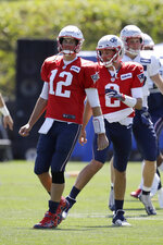 New England Patriots quarterbacks Tom Brady (12) and Brian Hoyer (2) warm up during an NFL football practice, Monday, Aug. 26, 2019, in Foxborough, Mass. (AP Photo/Steven Senne)
