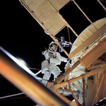 In this August 1973 photo made available by NASA, astronaut Owen K. Garriott retrieves an imagery experiment from the Apollo Telescope Mount attached to the Skylab in Earth orbit. The space agency said Garriott died at his home in Huntsville, Ala., on Monday, April 15. 2019. He was 88. (NASA via AP)
