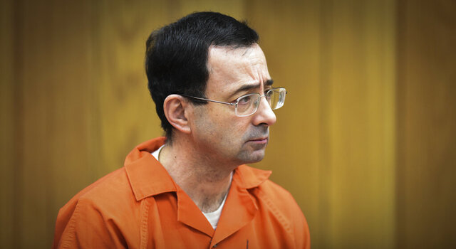 FILE - In this Feb. 5, 2018 file photo, Larry Nassar, former sports doctor who admitted molesting some of the nation's top gymnasts, appears in Eaton County Court in Charlotte, Mich. A spokeswoman said Tuesday, Dec. 24, 2019 that Michigan Attorney General Dana Nessel has suspended a nearly two-year-long investigation into Michigan State University's handling of complaints against now-imprisoned serial sexual abuser Larry Nassar. It is unclear if or when the investigation will resume.  (Matthew Dae Smith/Lansing State Journal via AP, File)