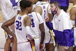 LSU coach Will Wade talks with members of the team during the second half of an NCAA college basketball game against Alabama in Baton Rouge, La., Tuesday, Jan. 19, 2021. (AP Photo/Brett Duke)