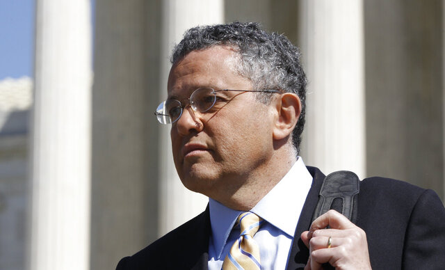 FILE - CNN legal analyst Jeffrey Toobin leaves the Supreme Court after it finished the day's arguments on the health care law signed by President Barack Obama in Washington on March 27, 2012. The New Yorker has parted ways with longtime staff writer Toobin after he reportedly exposed himself during a Zoom conference last month. He had already been on suspension and is also on leave from CNN, where he has been a legal commentator. (AP Photo/Charles Dharapak, File)