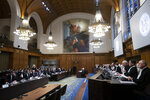 Judges take their seats prior to reading a ruling at the International Court in The Hague, Netherlands, Thursday, Jan. 23, 2020. The United Nations' top court is scheduled to issue a decision on a request by Gambia to order Myanmar to halt what has been cast as a genocidal campaign against the southeast Asian country's Rohingya Muslim minority. (AP Photo/Peter Dejong)
