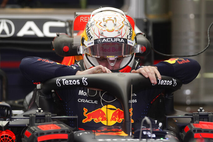 Red Bull driver Max Verstappen, of the Netherlands, climbs into his car for a practice session for the F1 US Grand Prix auto race at the Circuit of the Americas, Friday, Oct. 22, 2021, in Austin, Texas. (AP Photo/Darron Cummings)