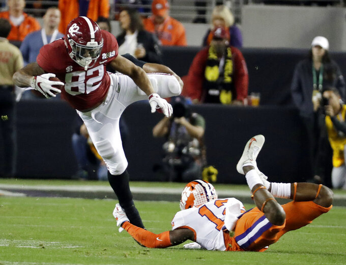 Clemson's K'Von Wallace stops Alabama's Irv Smith Jr. during the first half the NCAA college football playoff championship game, Monday, Jan. 7, 2019, in Santa Clara, Calif. (AP Photo/Chris Carlson)