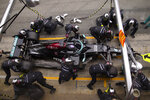 Mercedes driver Lewis Hamilton of Britain stops in the pit lane to change tires during the Spanish Formula One Grand Prix at the Barcelona Catalunya racetrack in Montmelo, just outside Barcelona, Spain, Sunday, May 9, 2021. (AP Photo/Emilio Morenatti)