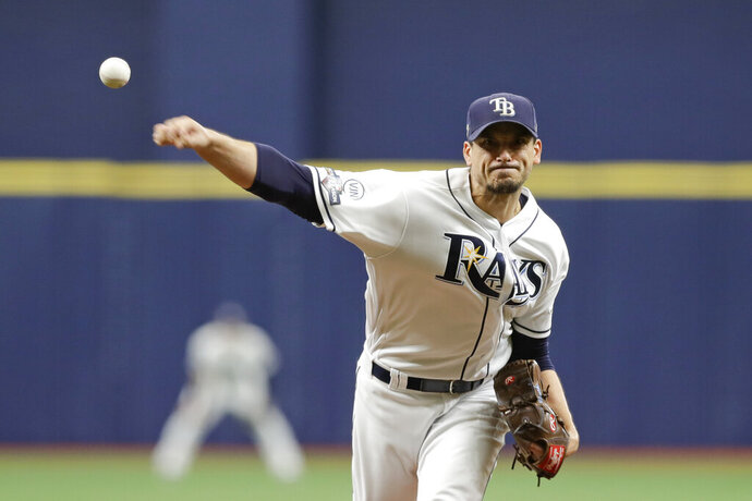 Tampa Bay Rays starting pitcher Charlie Morton (50) throws during the first inning of Game 3 of a baseball American League Division Series against the Houston Astros, Monday, Oct. 7, 2019, in St. Petersburg, Fla. (AP Photo/Chris O'Meara, Pool)