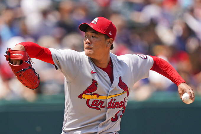 St. Louis Cardinals starting pitcher Kwang Hyun Kim delivers in the first inning of a baseball game against the Cleveland Indians, Wednesday, July 28, 2021, in Cleveland. (AP Photo/Tony Dejak)