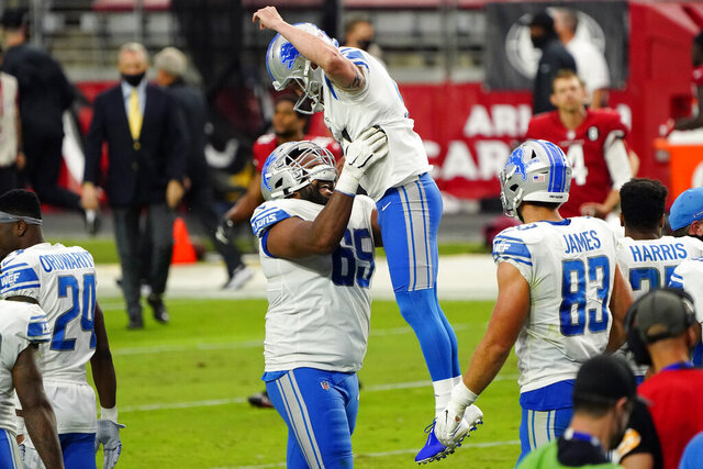 Detroit Lions kicker Matt Prater (5) celebrates after kicking the game winning field goal with teammate Tyrell Crosby (65) during the second half of an NFL football game against the Arizona Cardinals, Sunday, Sept. 27, 2020, in Glendale, Ariz. The Lions won 26-23. (AP Photo/Rick Scuteri)