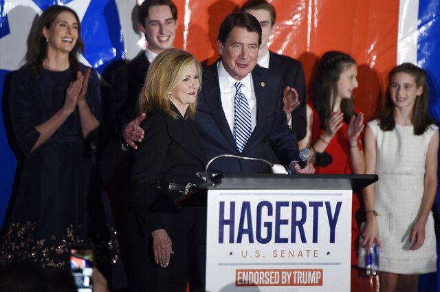 Republican Bill Hagerty, center, is joined by Sen. Marsha Blackburn, R-Tenn., after Hagerty was named the winner of his race for U.S. Senate Tuesday, Nov. 3, 2020, in Franklin, Tenn. (George Walker IV/The Tennessean via AP)