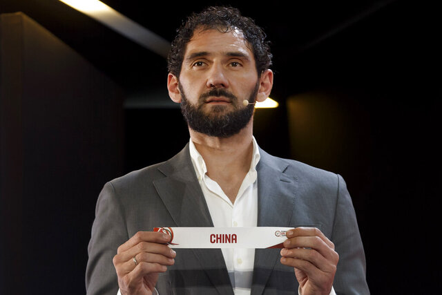 FILE - In this Wednesday, Nov. 27, 2019 file photo, Jorge Garbajosa, Spanish Basketball Federation President and former basketball player, shows a ticket of the China national basketball team, during the FIBA Olympic Qualifying Tournaments 2020 draw, at the headquarters of the FIBA (International Basketball Federation), in Mies, Switzerland. A former NBA player who got into basketball because it was the only sport with shoes big enough for him has been leading Spain to its most successful era in the sport. (Salvatore Di Nolfi/Keystone via AP, File)
