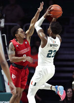 Miami guard Kameron McGusty (23) shoots as Louisville guard Lamarr Kimble defends during the first half of an NCAA college basketball game, Tuesday, Nov. 5, 2019, in Coral Gables, Fla. (AP Photo/Lynne Sladky)