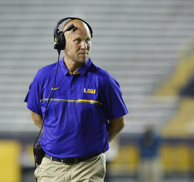 "FILE - In this April 22, 2017, file photo, then-LSU offensive coordinator Matt Canada coaches in the first half of the NCAA college football team's spring game, in Baton Rouge, La. Placing a priority on player safety after the death of Jordan McNair, Maryland interim coach Matt Canada has taken significant steps to ensure that the Terrapins are poised to deal with the heat of summer. Two tents are in place at practice field to provide shade. Underneath the awnings are several fans, liquids and ice. Practice sessions have been shortened to less than two hours, with time for breaks. ""The focus of our player's health and safety is No. 1, and our players are feeling that and understanding that,"" Canada said Wednesday, Aug. 15, 2018, before leading the team onto the field. (Hilary Scheinuk/The Advocate via AP, File)"