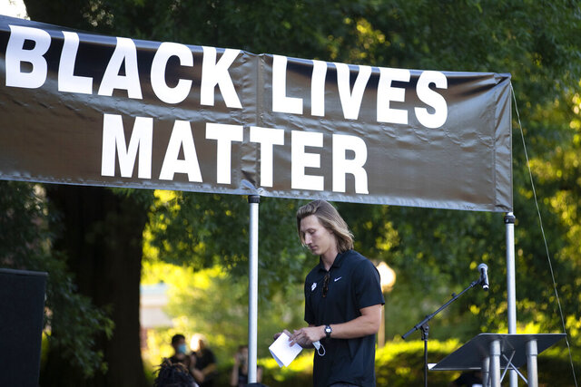 Clemson quarterback Trevor Lawrence steps away from the microphone after speaking Saturday, June 13, 2020, in Clemson, S.C., during a protest rally over the death of George Floyd who died after being restrained by Minneapolis police officers on May 25. (AP Photo/John Bazemore)