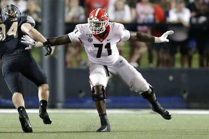 FILE - In this Aug. 31, 2019, file photo, Georgia offensive lineman Andrew Thomas (71) plays against Vanderbilt in the first half of an NCAA college football game, in Nashville, Tenn. Thomas was selected to The Associated Press All-Southeastern Conference football team, Monday, Dec. 9, 2019.(AP Photo/Mark Humphrey, File)