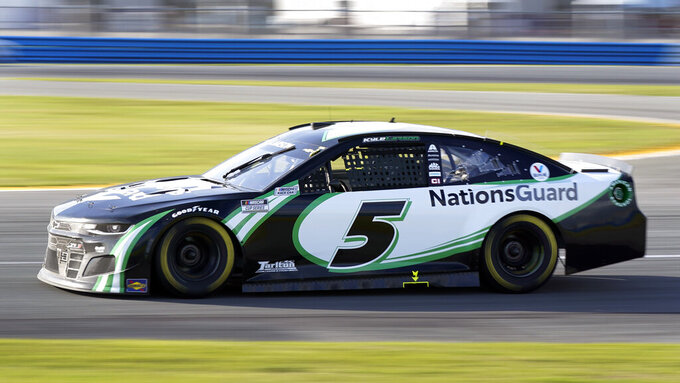 Kyle Larson (5) comes out of a turn during the NASCAR Cup Series road-course auto race at Daytona International Speedway, Sunday, Feb. 21, 2021, in Daytona Beach, Fla. (AP Photo/John Raoux)