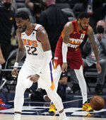 Phoenix Suns center Deandre Ayton reacts after dunking the ball in the second half of Game 4 of an NBA second-round playoff series against the Denver Nuggets, Sunday, June 13, 2021, in Denver. Phoenix won 125-118 to sweep the series. (AP Photo/David Zalubowski)