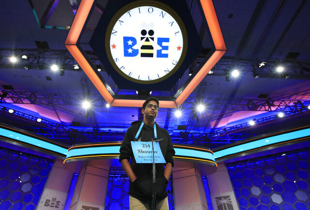 FILE - In this June 1, 2017 file photo, Shourav Dasari, 14, from Spring, Texas, correctly spells his word during the finals of the 90th Scripps National Spelling Bee, in Oxon Hill, Md.  With the 2020 Scripps National Spelling Bee canceled because the coronavirus pandemic, an online spelling bee launched by two Texas teenagers is offering a consolation prize of sorts, with competitors nationwide including many of the kids who were considered favorites for the Scripps title.(AP Photo/Manuel Balce Ceneta, File)