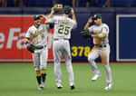 Oakland Athletics center fielder Ramon Laureano (22), right fielder Stephen Piscotty (25) and left fielder Robbie Grossman (8) celebrate after the team defeated the Tampa Bay Rays during a baseball game Wednesday, June 12, 2019, in St. Petersburg, Fla. Oakland defeated Tampa Bay 6-2. (AP Photo/Chris O'Meara)