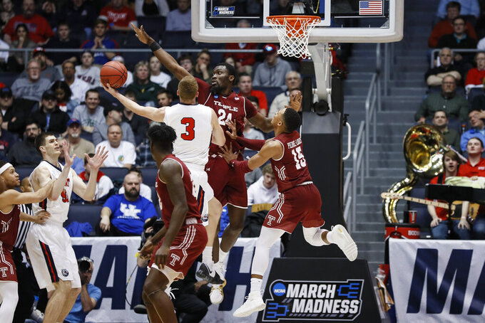 Belmont's Dylan Windler (3) shoots against Temple's Ernest Aflakpui (24) during the second half of a First Four game of the NCAA college basketball tournament, Tuesday, March 19, 2019, in Dayton, Ohio. (AP Photo/John Minchillo)