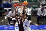 Mississippi State guard D.J. Stewart Jr. (3) has his shot blocked by Saint Louis forward Hasahn French (11) during the second half of an NCAA college basketball game in the first round of the NIT Tournament, Saturday, March 20, 2021, in Frisco, Texas. (AP Photo/Tony Gutierrez)